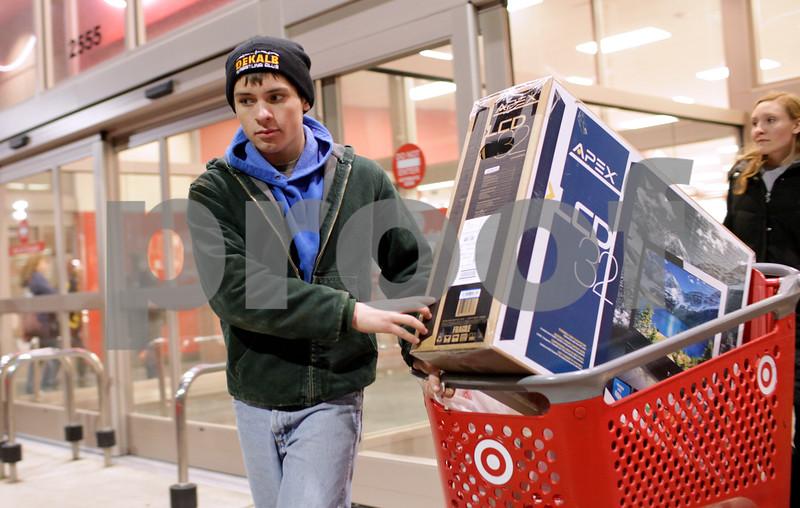 Kyle Bursaw – kbursaw@shawmedia.com<br /> <br /> Nick Roach, 15-year-old DeKalb resident, leaves Target with a 32-inch television in tow in DeKalb, Ill. on Thursday, Nov. 22, 2012