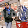 Kyle Bursaw – kbursaw@shawmedia.com<br /> <br /> Nick Roach, 15-year-old DeKalb resident, leaves Target with a 32-inch television in tow in DeKalb, Ill. on Thursday, Nov. 22, 2012