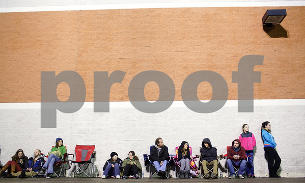 Kyle Bursaw – kbursaw@shawmedia.com<br /> <br /> The line of shoppers waiting for Black Friday deals at Best Buy in DeKalb, Ill. continues around the side of the store on Thursday, Nov. 22, 2012.