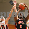 Kyle Bursaw – kbursaw@shawmedia.com<br /> <br /> DeKalb foreward Janay Wright shoots over the outstretched arm of Naperville North's Lauren LoLordo in the second quarter of DeKalb's 49-30 victory over Naperville North in the Lady War Hawk Thanksgiving girls basketball tournament at West Aurora High School on Friday, Nov. 23, 2012