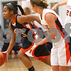 Kyle Bursaw – kbursaw@shawmedia.com<br /> <br /> DeKalb guard Brittney Patrick takes off down the court after forcing a turnover in the fourth quarter of DeKalb's 49-30 victory over Naperville North in the Lady War Hawk Thanksgiving girls basketball tournament at West Aurora High School on Friday, Nov. 23, 2012