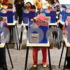 Kyle Bursaw – kbursaw@shawmedia.com<br /> <br /> Voters including Jaciel Cathey (front right) cast their ballots at Westminster Presbyterian Church in DeKalb, Ill. on Tuesday, Nov. 6, 2012.