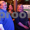 Kyle Bursaw – kbursaw@shawmedia.com<br /> <br /> Richard Schmack reacts with supporters Victoria Weernink (center) and Regina Harris to results showing Schmack leading opponent Clay Campbell on a television at Joker's Bar and Grill in Sycamore, Ill. on Tuesday, Nov. 6, 2012.