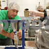 Rob Winner – rwinner@shawmedia.com<br /> <br /> Volunteer Alan Bauer, of Sycamore, holds a bag to be filled with rice during the first shift of the Feed My Starving Children MobilePack event at The Suter Co. Inc. in Sycamore, Ill., Friday, Nov. 16, 2012.