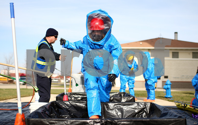 Kyle Bursaw – kbursaw@shawmedia.com<br /> <br /> A member of MABAS division six advances from one section of the decontamination area to the next during a simulation near the water tower on West Dresser Road in DeKalb, Ill. on Thursday, Nov. 15, 2012. MABAS stands for Mutual Aid Box Alarm System and the division is composed of members of multiple fire departments including.