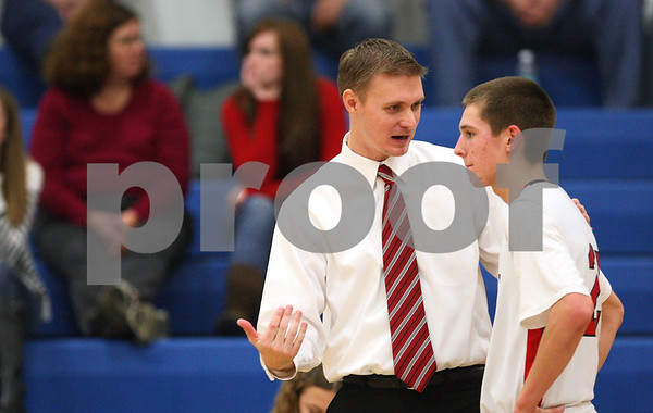 Kyle Bursaw – kbursaw@shawmedia.com<br /> <br /> Indian Creek coach Joe Piekarz talks to guard Noah Holm in the fourth quarter. Indian Creek defeated Alden-Hebron 61-30 in the Warrior Thanksgiving Basketball Classic at Westminster Christian High School in Elgin, Ill. on Tuesday, Nov. 20, 2012.