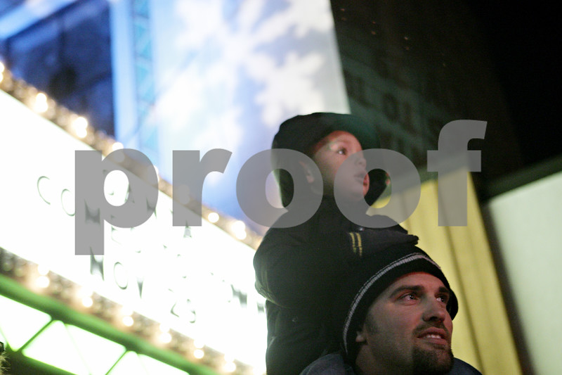 Rob Winner – rwinner@shawmedia.com<br /> <br /> Landon Farr, 3, of DeKalb, and his father Justin Farr await the arrival of Santa Claus outside the Egyptian Theatre in downtown DeKalb, Ill., Thursday, Nov. 29, 2012.
