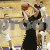 Rob Winner – rwinner@shawmedia.com<br /> <br /> Sycamore's Ben Niemann (20) puts up a shot during the first quarter in Rochelle, Ill., Friday, Nov. 30, 2012.