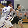 Rob Winner – rwinner@shawmedia.com<br /> <br /> Sycamore's Mark Skelley (right) moves the ball during the second quarter in Rochelle, Ill., Friday, Nov. 30, 2012.