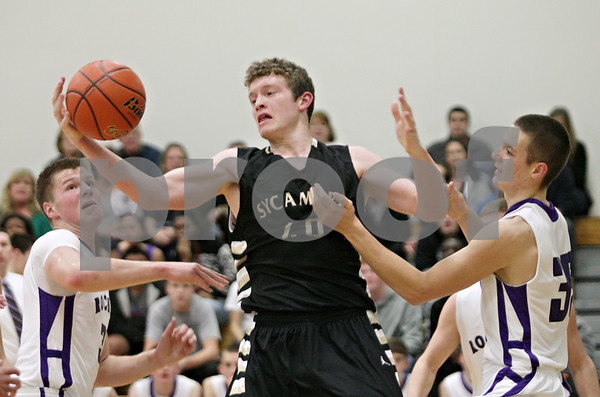 Rob Winner – rwinner@shawmedia.com<br /> <br /> Sycamore's Scott Nelson (40) controls an offensive rebound during the second quarter in Rochelle, Ill., Friday, Nov. 30, 2012.