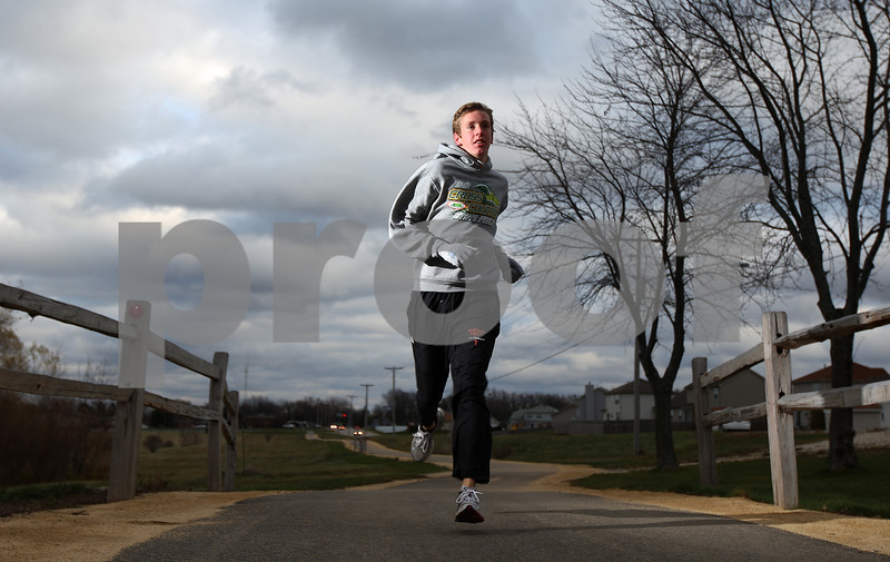 Kyle Bursaw – kbursaw@shawmedia.com<br /> <br /> DeKalb's Marc Dubrick is the Daily Chronicle's 2012 boys cross country runner of the year.<br /> <br /> Photographed near Katz Park in DeKalb, Ill. on Monday, Nov. 12, 2012.