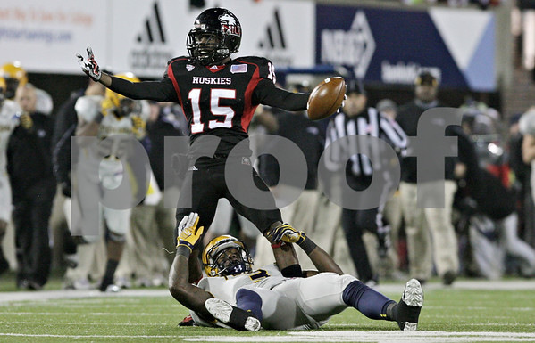 Rob Winner – rwinner@shawmedia.com<br /> <br /> Northern Illinois defensive back Jimmie Ward (15) celebrates his interception during the second quarter in DeKalb, Ill., Wednesday, Nov. 14, 2012. NIU defeated Toledo, 31-24.
