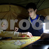 Kyle Bursaw – kbursaw@shawmedia.com<br /> <br /> Erica Klein (from left), Benjamin Taour, and Chase Olson play a game of Risk in their tent at the front of the line outside Best Buy in DeKalb, Ill. on Thursday, Nov. 22, 2012. The group, who said they had been waiting since 5 p.m. on Wednesday were all there for different items. Taour, a 17-year-old from Oregon, Ill., was waiting for a television and  laptop; 15-year-old Olson, a Mount Carroll resident, was waiting for an iPod and Klein, a 19-year-old from DeKalb, was not sure what she would buy.