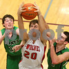 Kyle Bursaw – kbursaw@shawmedia.com<br /> <br /> Indian Creek's Stephen Muetz snags a rebound between Jacob Heaver (left) and another Alden-Hebron player in the third quarter. Indian Creek defeated Alden-Hebron 61-30 in the Warrior Thanksgiving Basketball Classic at Westminster Christian High School in Elgin, Ill. on Tuesday, Nov. 20, 2012.