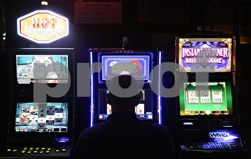Rob Winner – rwinner@shawmedia.com<br /> <br /> David Busch plays one the new video gambling machines at Houlahan's Tavern and Grill in Waterman, Ill., Friday, Nov. 16, 2012. The tavern, which has three gambling machines, is one of the first in DeKalb county.