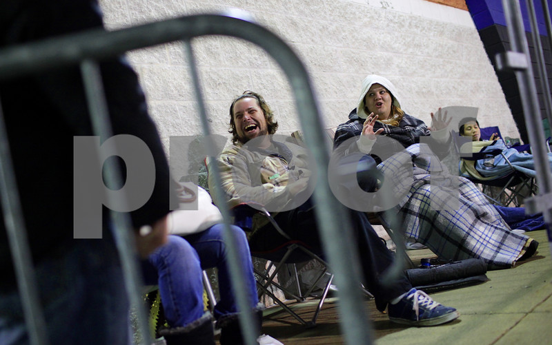 Kyle Bursaw – kbursaw@shawmedia.com<br /> <br /> John and Angela Davis, of DeKalb, joke around with their fellow shoppers waiting near the front of the line at Best Buy in DeKalb, Ill. on Thursday, Nov. 22, 2012.