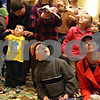 Rob Winner – rwinner@shawmedia.com<br /> <br /> Jefferson Slutzky, 4, of Sycamore, and his mother Heather Slutzky listen to the madrigal singers inside the Egyptian Theatre before the arrival of Santa Claus in downtown DeKalb, Ill., Thursday, Nov. 29, 2012.