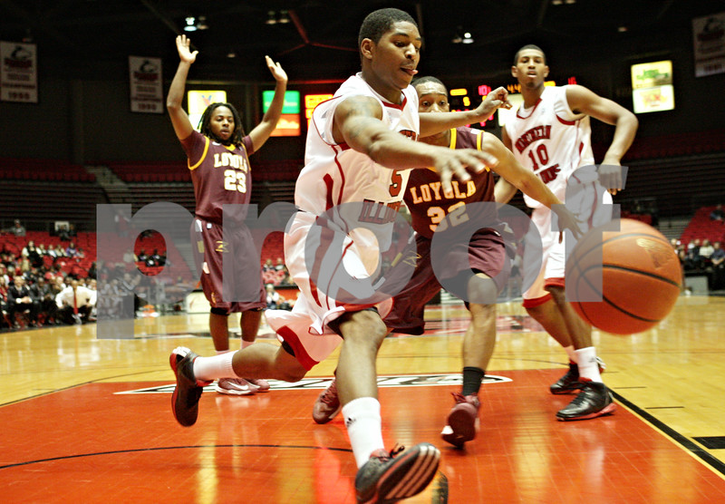 Rob Winner – rwinner@shawmedia.com<br /> <br /> Northern Illinois guard Travon Baker (5) nearly loses the ball under the Huskies' basket during the first half of a game against Loyola in DeKalb, Ill., Saturday, Nov. 24, 2012. Loyola defeated NIU, 53-46.