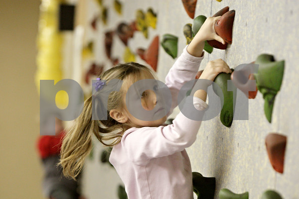Rob Winner – rwinner@shawmedia.com<br /> <br /> Adrina Rogers, 5, scales a climbing wall in the Activity Center at the Kishwaukee Family YMCA in Sycamore, Ill., Tuesday, Nov. 27, 2012.