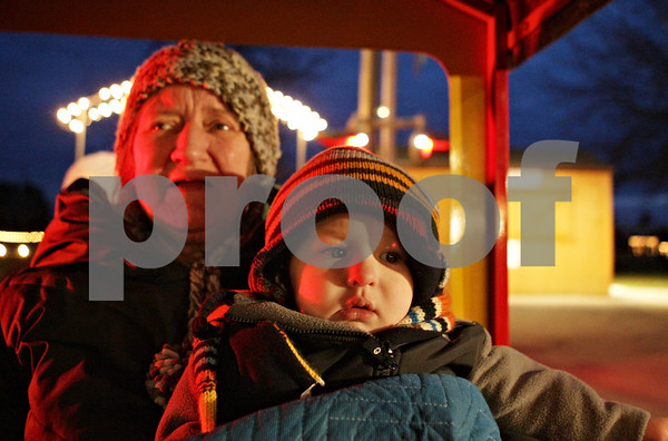 Rob Winner – rwinner@shawmedia.com<br /> <br /> Thyra Nichols, of Kankakee, and her grandson, Caylin Russell, 1, of Sheridan, arrive back at the station after taking a ride on the Holiday Lights Train at Lions Community Park in Waterman, Ill., Saturday, Nov. 24, 2012. This is the 19th annual Holiday Lights Train event that runs until the end of December and admission is free.