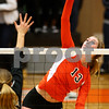 Kyle Bursaw – kbursaw@shawmedia.com<br /> <br /> DeKalb's Courtney Bemis goes for a kill during the second game against Sycamore. Sycamore defeated DeKalb 28-26, 25-21 at DeKalb High School on Thursday, Oct. 4, 2012