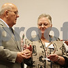 Rob Winner – rwinner@shawmedia.com<br /> <br /> Michael (left) and Jenelle Muzzillo are honored on stage with help from Amy Polzin (right) during the Three Fires Council Boy Scouts America 10th annual DeKalb County Tribute to Heroes at Kishwaukee College in Malta Thursday evening.
