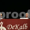 Rob Winner – rwinner@shawmedia.com<br /> <br /> State's attorney Clay Campbell (left) listens as candidate Richard Schmack makes his closing statements during the DeKalb Chamber of Commerce Candidates Night at the Egyptian Theatre Wednesday night.