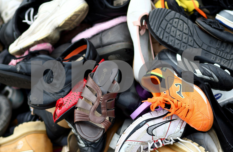 Kyle Bursaw – kbursaw@shawmedia.com<br /> <br /> A pile of donated shoes outside the Holmes Student Center for the annual Day Without Shoes put on by NIU's Engineers Without Borders club on Thursday, Oct. 4, 2012.