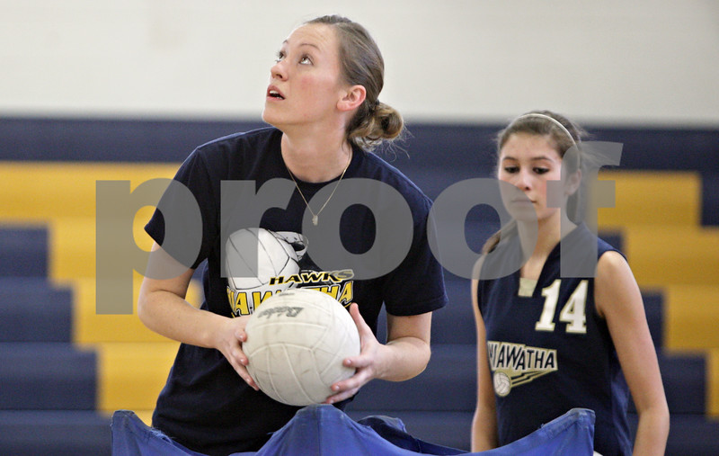 Rob Winner – rwinner@shawmedia.com<br /> <br /> Hiawatha volleyball coach Jenna Araujo prepares her players before a game against Paw Paw in Kirkland Thursday evening. Araujo is a former Division 1 basketball standout.<br /> <br /> Thursday, Sept. 27, 2012