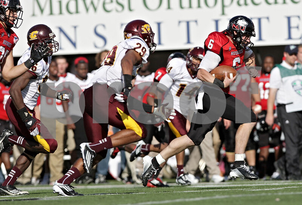 Rob Winner – rwinner@shawmedia.com<br /> <br /> Northern Illinois quarterback Jordan Lynch (6) carries the ball for a first down during the second quarter at Huskie Stadium in DeKalb, Ill., Saturday, Sept. 29, 2012. Northern Illinois defeated Central Michigan, 55-24.