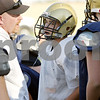 Rob Winner – rwinner@shawmedia.com<br /> <br /> Hiawatha center Ben Watson (center) listens as coach Sean Donnelly addresses his offense during practice in Kirkland Tuesday afternoon.