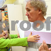 Kyle Bursaw – kbursaw@shawmedia.com<br /> <br /> Malta Elementary kindergartner Alissa Kocjan uses the large card she made, a face with long arms, to give her grandfather Ed Kocjan a hug during the school's grandparent day on Thursday, Oct. 4, 2012.