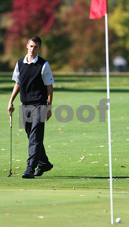 Kyle Bursaw – kbursaw@shawmedia.com<br /> <br /> Kyle Buzzard reacts after narrowly missing the hole on the fourth green at Sycamore Golf Course on Tuesday, Oct. 2, 2012.