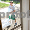 Kyle Bursaw – kbursaw@shawmedia.com<br /> <br /> DeKalb police officer Lance Reinbolz helps fellow officer Jared Burke move some furniture into Burke's new home on North Eleventh Street on Friday, Sept. 28, 2012. Burke will be living in the home as part of the resident officer program.