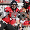 Rob Winner – rwinner@shawmedia.com<br /> <br /> Northern Illinois quarterback Jordan Lynch (6) flips the ball to Leighton Settle (23) during the first quarter at Huskie Stadium in DeKalb, Ill., Saturday, Sept. 29, 2012. Northern Illinois defeated Central Michigan, 55-24.