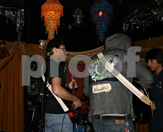 Jeff Engelhardt – jengelhardt@shawmedia.com<br /> Cody Daniels, left, of The Stockyards, gets ready to perform Sunday at The House Cafe for the album release party of DeKalb Brawl City.