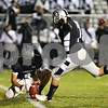 Kyle Bursaw – kbursaw@shawmedia.com<br /> <br /> Kaneland's Drew David (4) holds the ball as kicker Matt Rodriguez kicks an extra point during the first quarter of a game against DeKalb in Maple Park on Friday, Sept. 28, 2012.