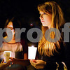 Kyle Bursaw – kbursaw@shawmedia.com<br /> <br /> Amy Howe (right) and Kelsey Vazquez hand out candles to attendees at Safe Passage's annual domestic violence vigil just outside the DeKalb Area Women's Center on Monday, Oct. 1, 2012. The two NIU students were volunteers through the Student Nurses' Organization.