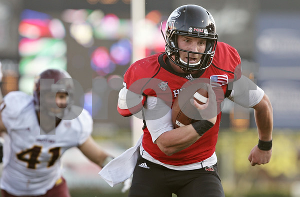 Rob Winner – rwinner@shawmedia.com<br /> <br /> Northern Illinois quarterback Jordan Lynch carries the ball 9 yards for a touchdown during the third quarter at Huskie Stadium in DeKalb, Ill., Saturday, Sept. 29, 2012. Northern Illinois defeated Central Michigan, 55-24.