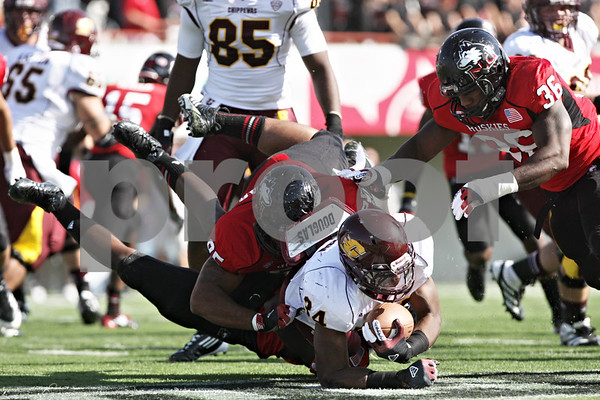 Rob Winner – rwinner@shawmedia.com<br /> <br /> Northern Illinois defensive end Sean Progar (top) tackles Central Michigan running back Zurlon Tipton (34) during the first quarter at Huskie Stadium in DeKalb, Ill., Saturday, Sept. 29, 2012. Northern Illinois defeated Central Michigan, 55-24.