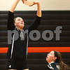 Kyle Bursaw – kbursaw@shawmedia.com<br /> <br /> Sycamore's Ratasha Garbes sets the ball during the second game of their 28-26, 25-21victory over DeKalb at DeKalb High School on Thursday, Oct. 4, 2012