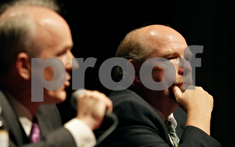 Rob Winner – rwinner@shawmedia.com<br /> <br /> State's attorney candidate Richard Schmack (right) listens as Clay Campbell makes his closing statements during the DeKalb Chamber of Commerce Candidates Night at the Egyptian Theatre Wednesday night.