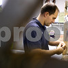 Kyle Bursaw – kbursaw@shawmedia.com<br /> <br /> Chris Puentes, owner of Soft Water City, rebuilds a control valve for a commercial water conditioner  on Thursday, Sept. 27, 2012.