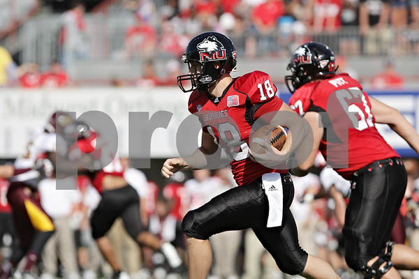 Rob Winner – rwinner@shawmedia.com<br /> <br /> Northern Illinois punter Ryan Neir (18) carries the ball on a fake punt attempt for a first down during the first quarter at Huskie Stadium in DeKalb, Ill., Saturday, Sept. 29, 2012. Northern Illinois defeated Central Michigan, 55-24.