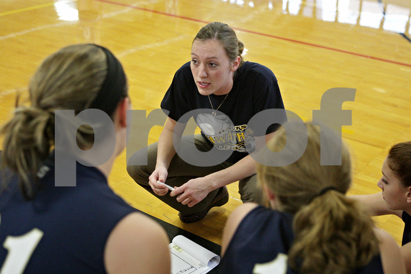 Rob Winner – rwinner@shawmedia.com<br /> <br /> Hiawatha volleyball coach Jenna Araujo gathers her team before a game against Paw Paw in Kirkland Thursday evening. Araujo is a former Division 1 basketball standout.<br /> <br /> Thursday, Sept. 27, 2012
