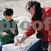 Gregory Losiniecki, 6, and his mom, Nikki Losiniecki of Cortland, look for fossils Saturday at the Vulcan Materials Company quarry in Sycamore.<br /> <br /> By Nicole Weskerna - nweskerna@shawmedia.com