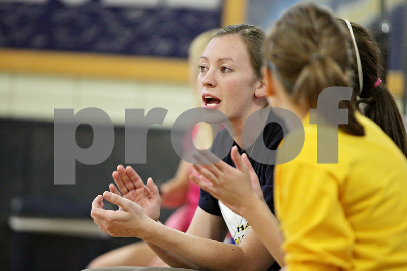 Rob Winner – rwinner@shawmedia.com<br /> <br /> Encouraged by her team's play, Hiawatha volleyball coach Jenna Araujo cheers from the bench during a game against Paw Paw in Kirkland Thursday evening. Araujo is a former Division 1 basketball standout.<br /> <br /> Thursday, Sept. 27, 2012
