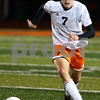 Kyle Bursaw – kbursaw@shawmedia.com<br /> <br /> DeKalb's Will Ferguson dribbles the ball in the first half of the Barbs game against Sycamore at DeKalb High School on Thursday, Oct. 4, 2012.