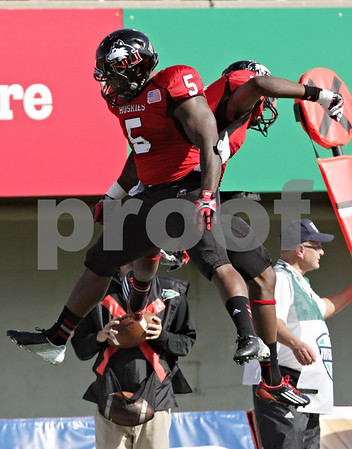 Rob Winner – rwinner@shawmedia.com<br /> <br /> Northern Illinois' Jamal Womble (5) and Martel Moore celebrate Moore's 14-yard touchdown reception during the first quarter at Huskie Stadium in DeKalb, Ill., Saturday, Sept. 29, 2012. Northern Illinois defeated Central Michigan, 55-24.