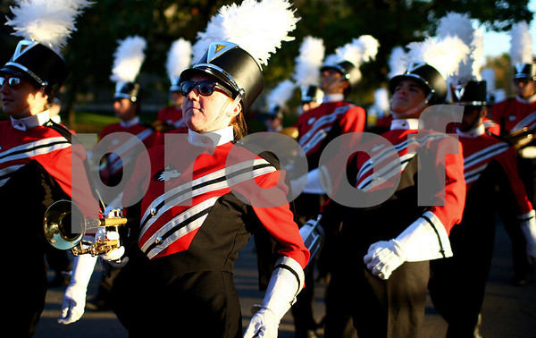 Kyle Bursaw — kbursaw@shawmedia.com<br /> <br /> Members of the NIU marching band make their way north on Stadium Drive East during Northern Illinois University's homecoming parade on Friday, Oct. 12, 2012.